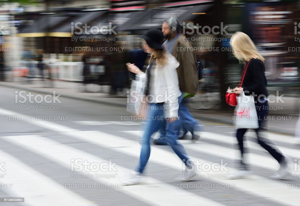 Women with H&M (H and M) bags stock photo