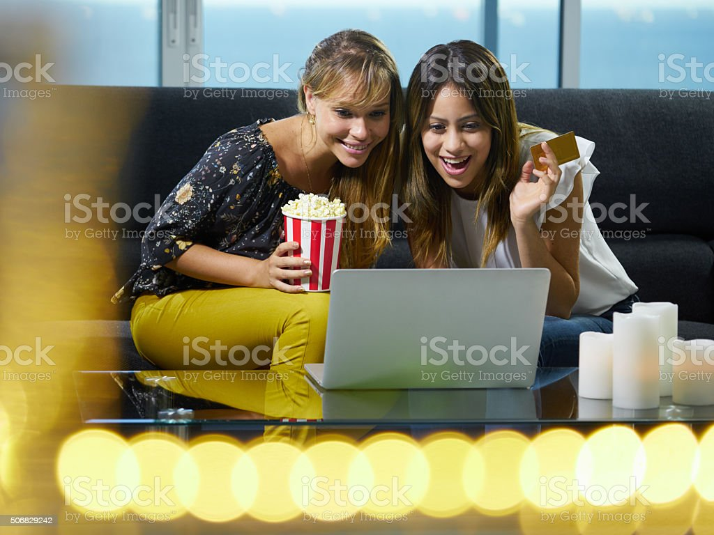 Women With Laptop PC Bidding At Online Auction stock photo