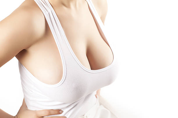 women with large breasts in a white shirt stock photo
