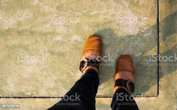 Women with leather shoes steps on concrete floor picture id977476776?b=1&k=6&m=977476776&s=612x612&h=6scbqaqsu77nwogtvy79rdzgi7pvswbhmr1wbxfckvc=