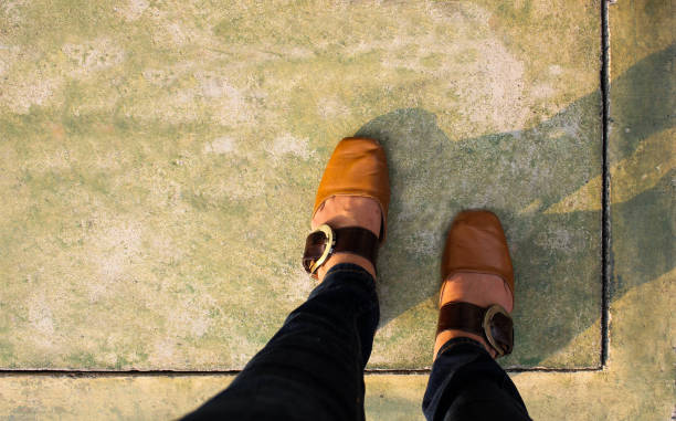 Women with Leather Shoes Steps on Concrete Floor stock photo