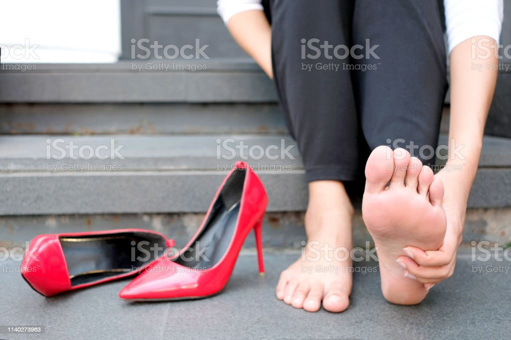 Women with leg cramps and ankles from high heels. She sat on the...