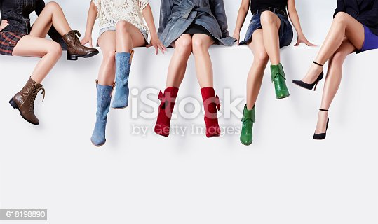istock Women with many colorful shoes sitting together. 618198890