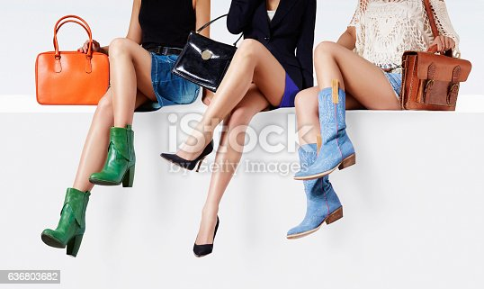 istock Women with many colorful shoes sitting together. 636803682