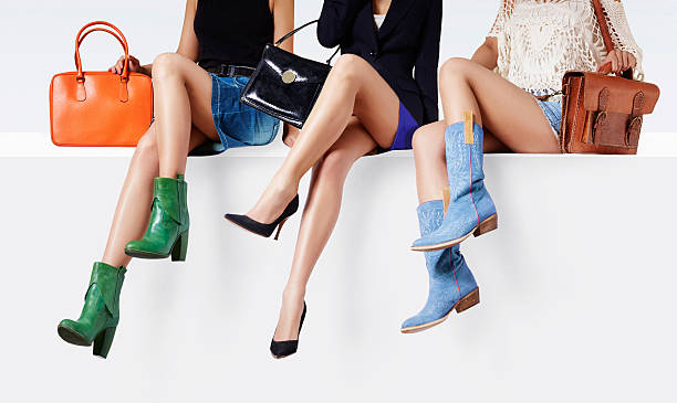 Women with many colorful shoes sitting together. - foto de stock