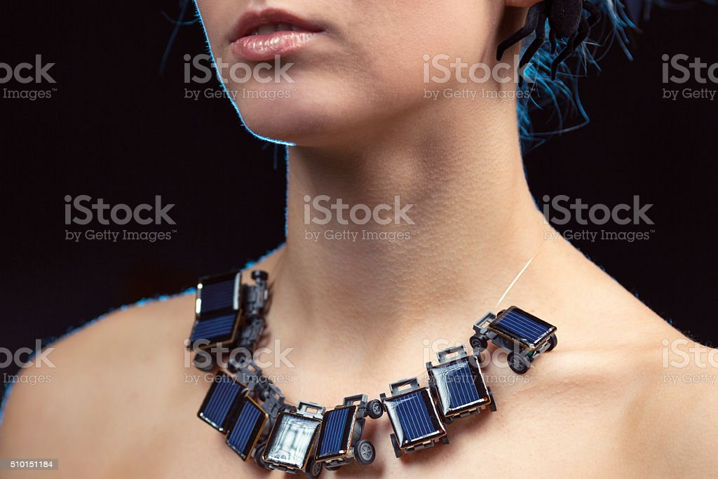 Women with Necklace from Small Solar Panels stock photo