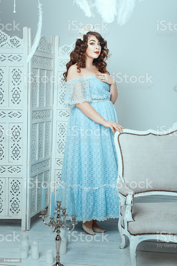 Women with overweight standing in the room. stock photo