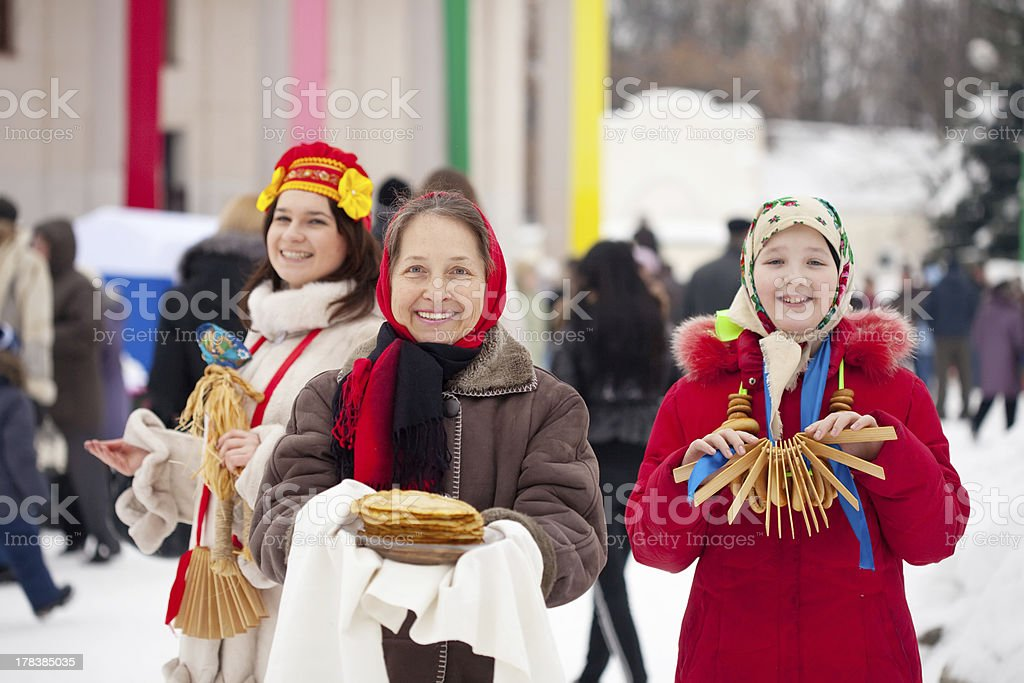 women  with pancake during  Shrovetide royalty-free stock photo