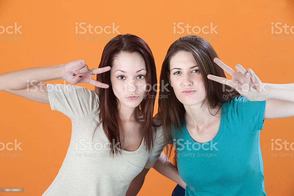 Women with Peace Symbol Hand Signs royalty-free stock photo