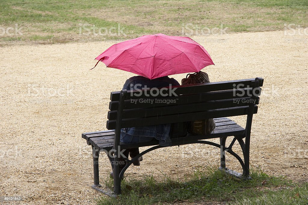 women with pink umbrella stock photo