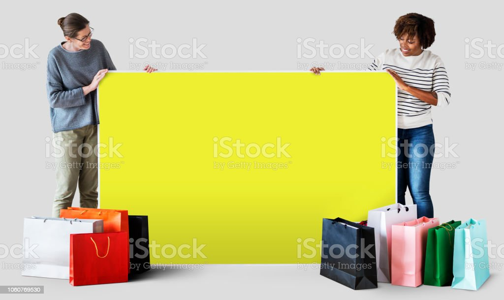 Women with shopping bags and a banner stock photo