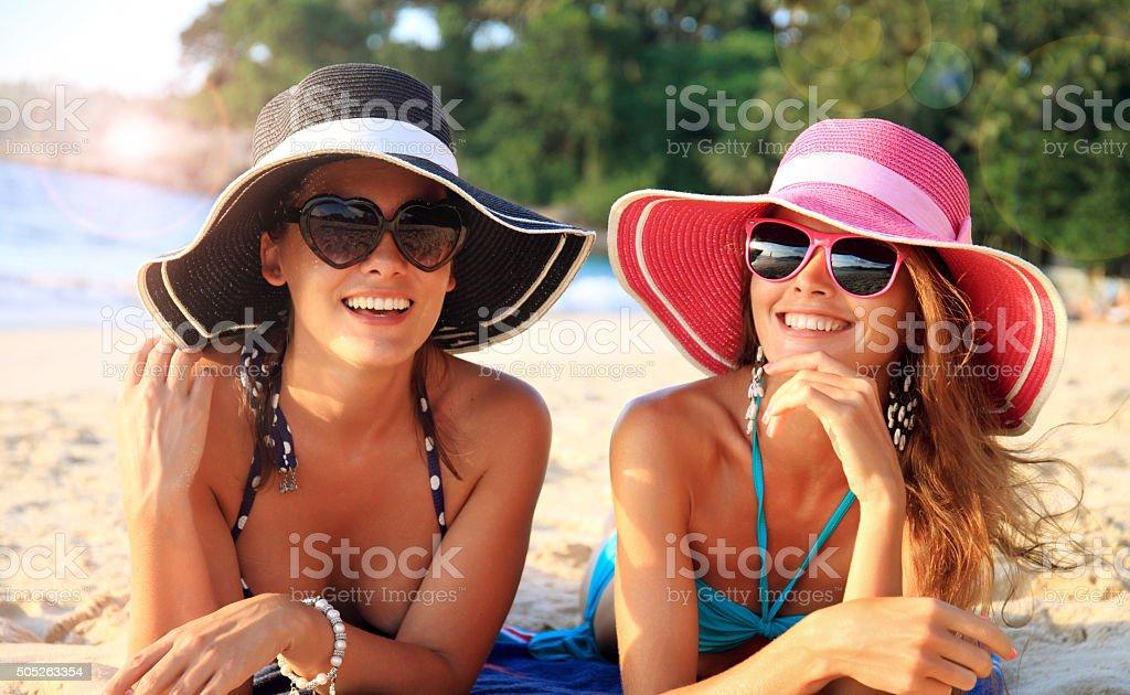 Women with sunhats stock photo