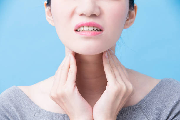 women with thyroid gland problem women with thyroid gland problem on the blue background carcinoma stock pictures, royalty-free photos & images