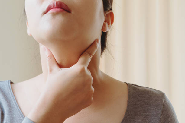 Women with thyroid gland test . Endocrinology, hormones and treatment. Inflammation of the sore throat stock photo