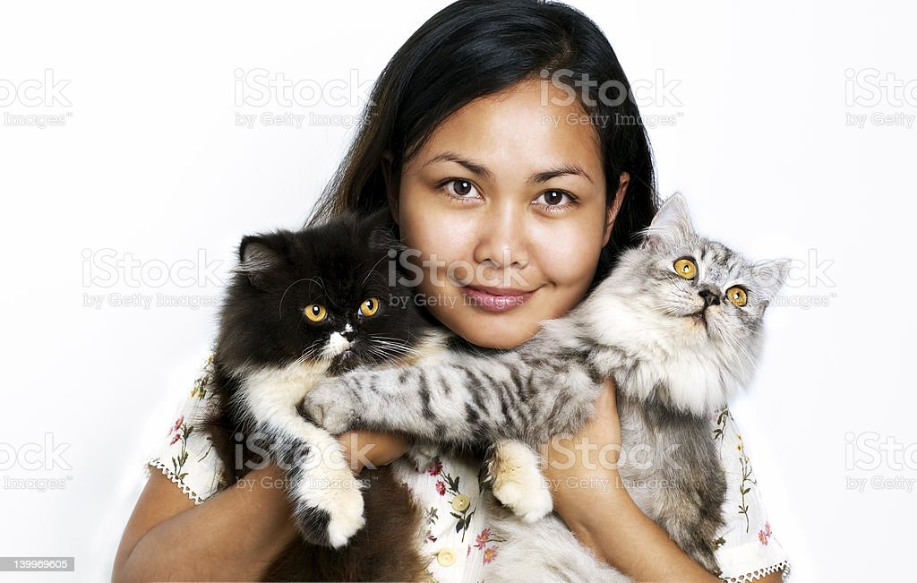 Women with two cats stock photo