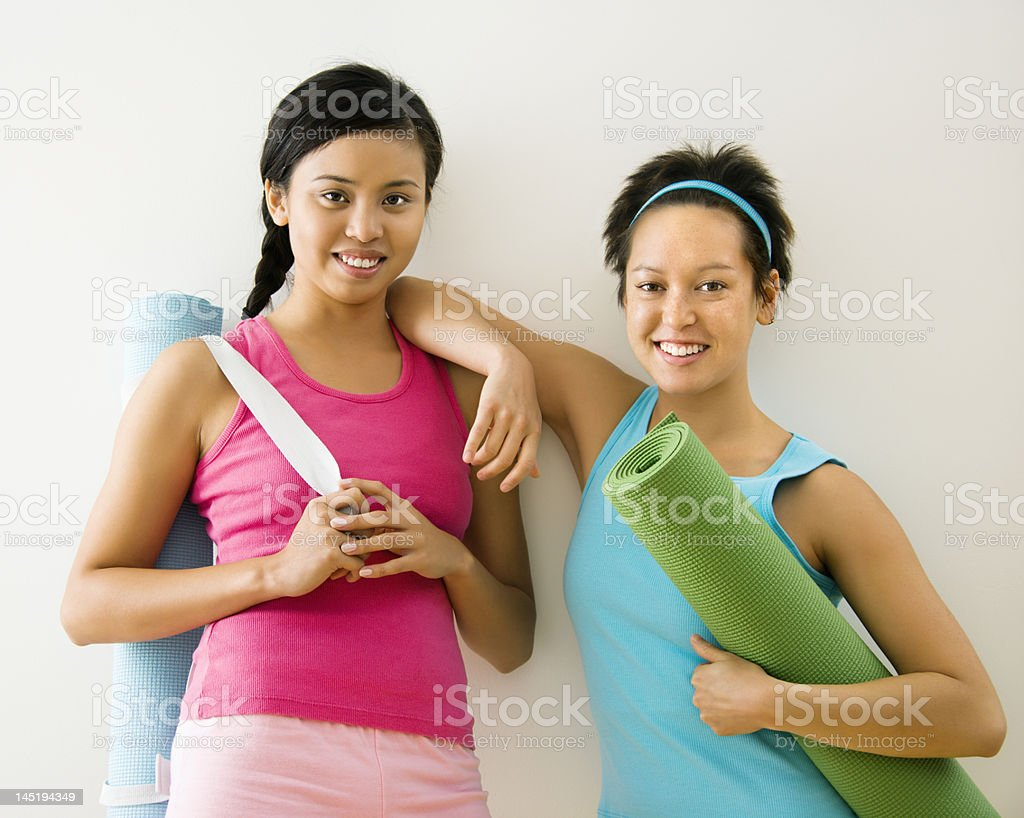 Women with yoga mats royalty-free stock photo