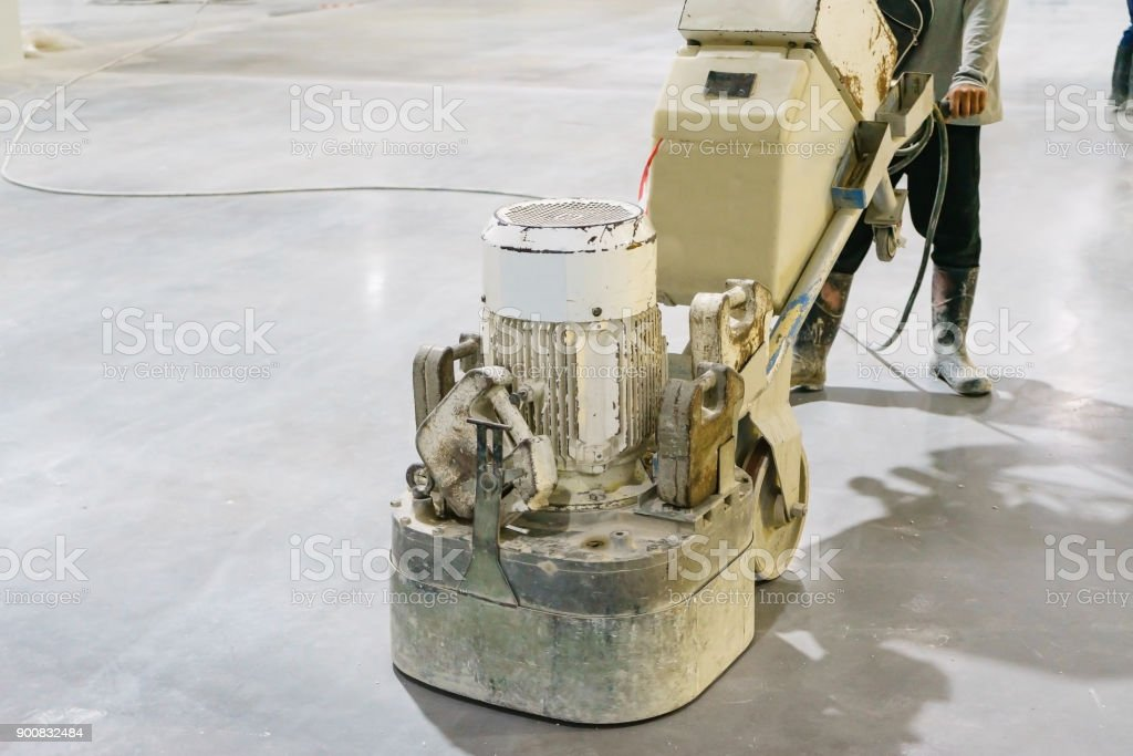 Women worker using polishing machine for smoothing surface to finish concrete slab.concrete floors foto stock royalty-free