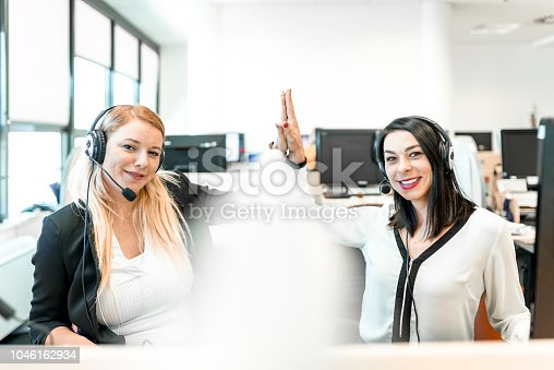 1031394114 istock photo Women working at a call center 1046162934