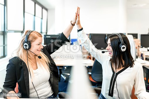 1031394114 istock photo Women working at a call center 1046162952