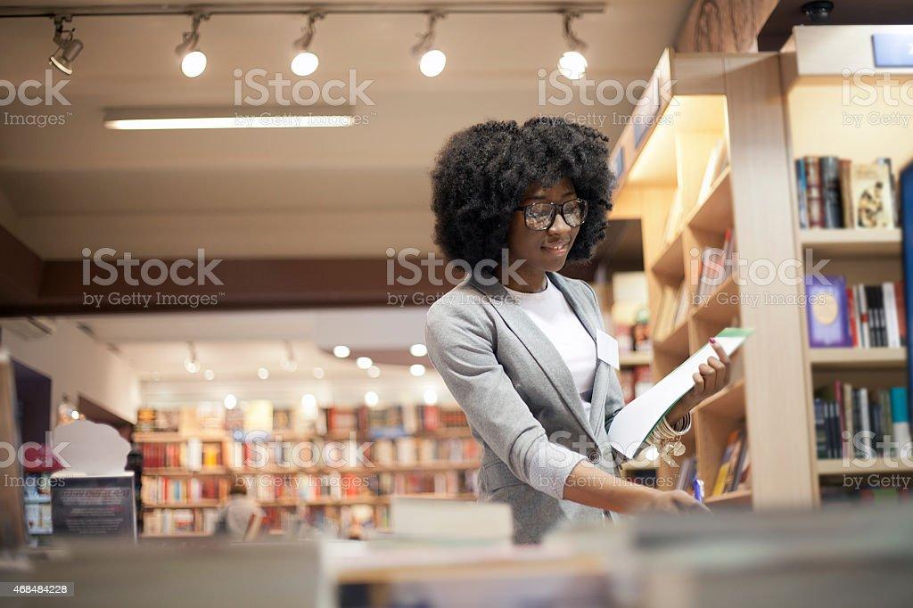 Women working at bookstore stock photo