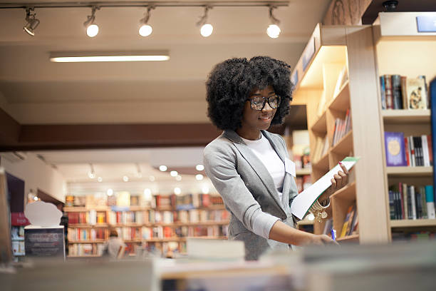 Women working at bookstore stock photo