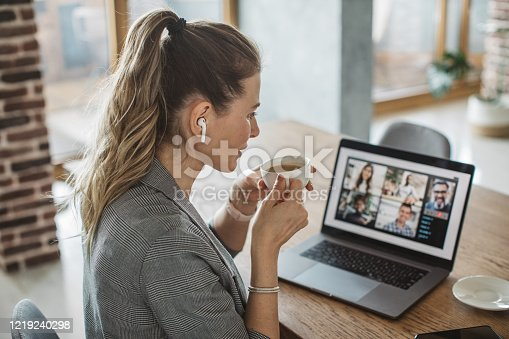 Women at home during pandemic isolation have conference  call