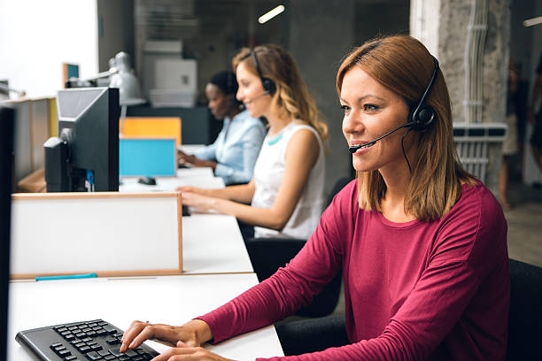 Women Working In Call Center. stock photo