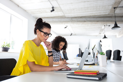 Women Working In Design Office Stock Photo - Download Image Now