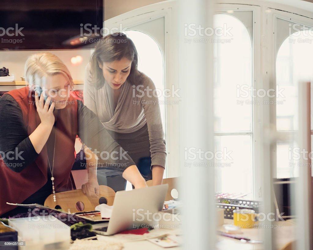 Women working in small creative fashion enterprise. bildbanksfoto