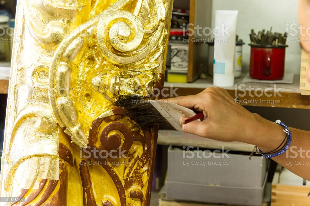 Women working on Antique Gold Picture Frame stock photo