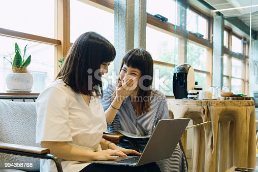 557608497istockphoto women working on laptop computers. 994358768