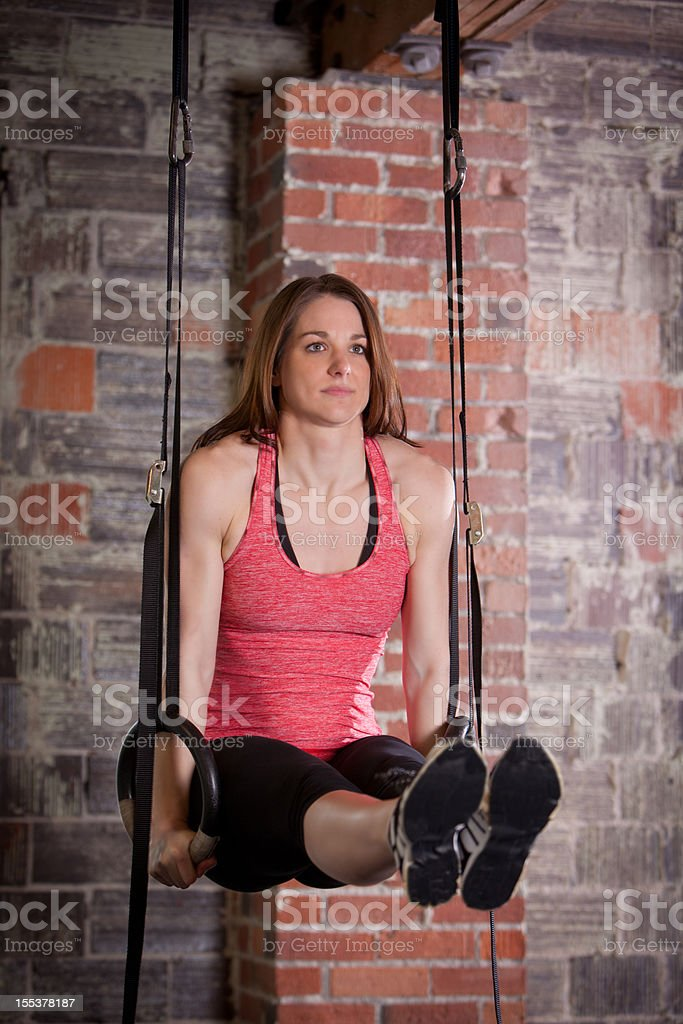 Women working out on rings in a gym royalty-free stock photo
