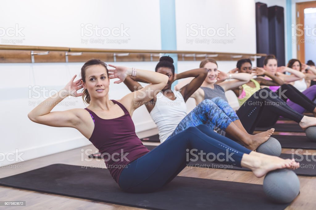 Women Working Out Together at Modern Gym stock photo