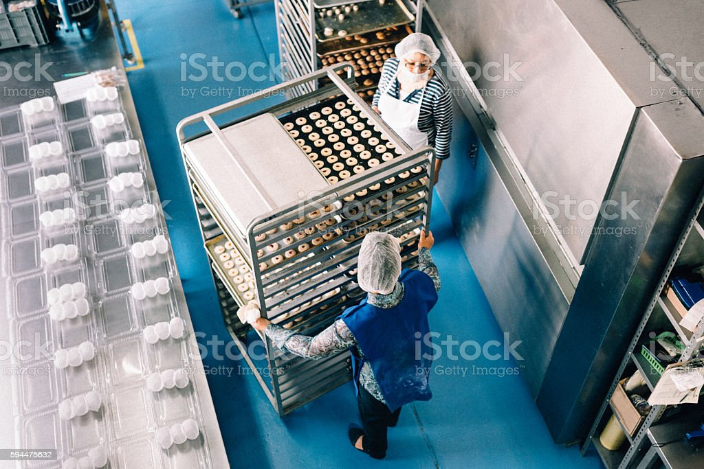 Women working together at Bakery Workshop stock photo