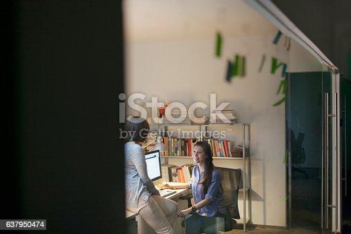 istock Women working together in design studio at night 637950474