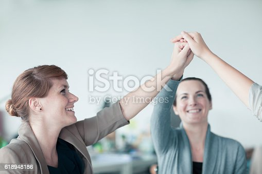 istock Women working together in teamwork in contemporary design office 618948186