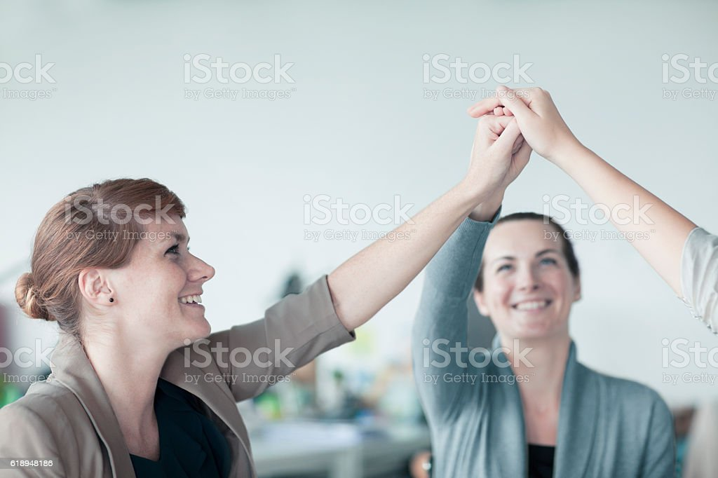Women working together in teamwork in contemporary design office stock photo