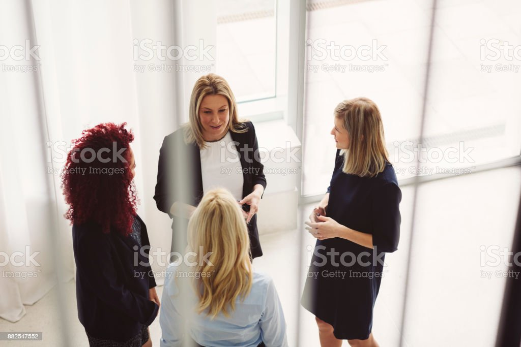 Women Working Together In The Modern Office stock photo