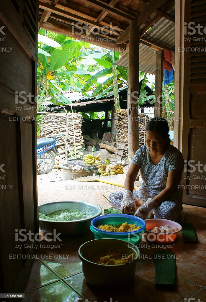 Women wrap up Cylindric glutinous rice cake stock photo