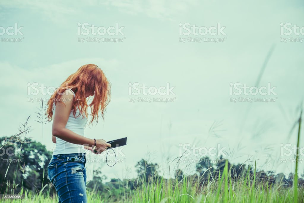 Women write notes Nature trails, mountains, forests. Writer. Asian women stock photo