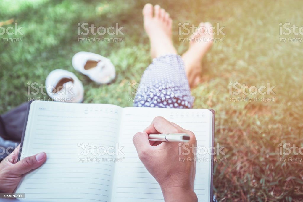Women write notes Nature trails, mountains, forests. Writer stock photo
