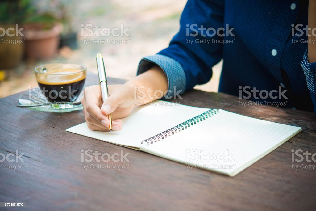 women writing and key board coffee on wooden table royalty-free stock photo