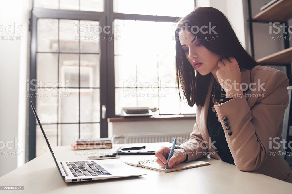 Women writing in diary. Writer concept. stock photo