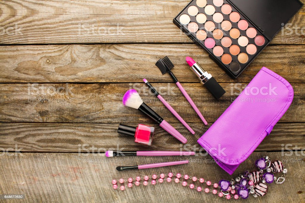 Women's accessories: cosmetic bag, makeup brushes, necklace, nail polish, lipstick stock photo