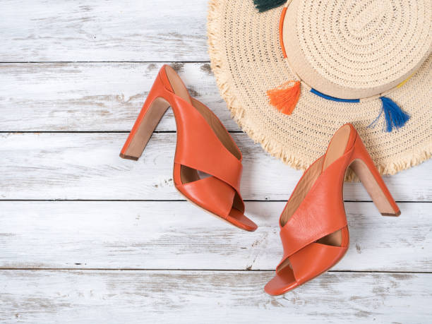 womens accessories,  footwear  (straw hat, open toe criss cross leather mule heels shoes). fashion outfit, spring summer collection. shopping concept. flat lay, view from above - spring fashion stock pictures, royalty-free photos & images