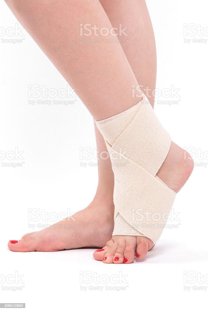 Women's ankle tied with an elastic bandage royalty-free stock photo