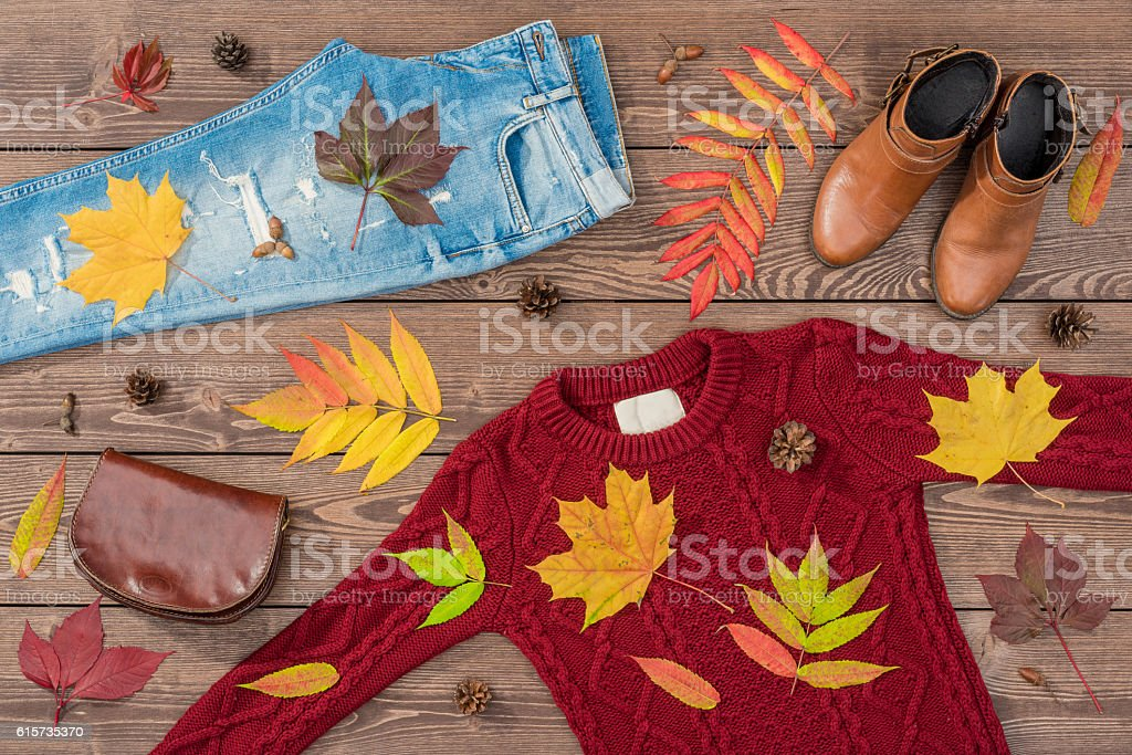 Women's autumn outfit on wooden background stock photo