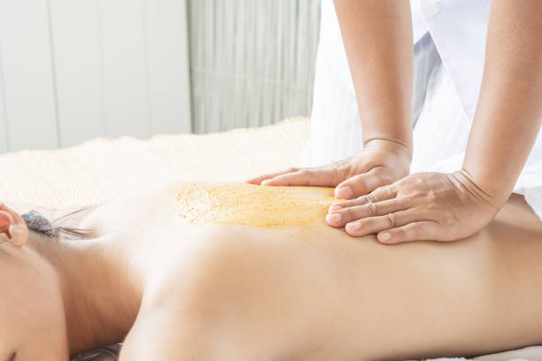 Women's Back Massage and Herbal stock photo