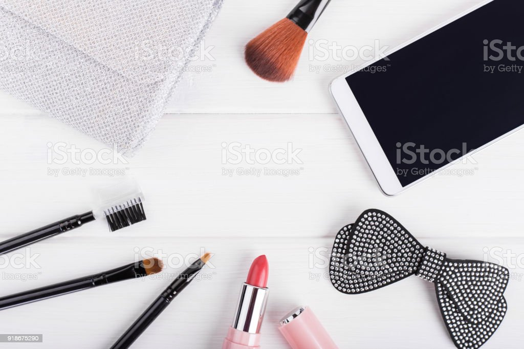 Women's bag, lipstick, hair clip, phone stock photo