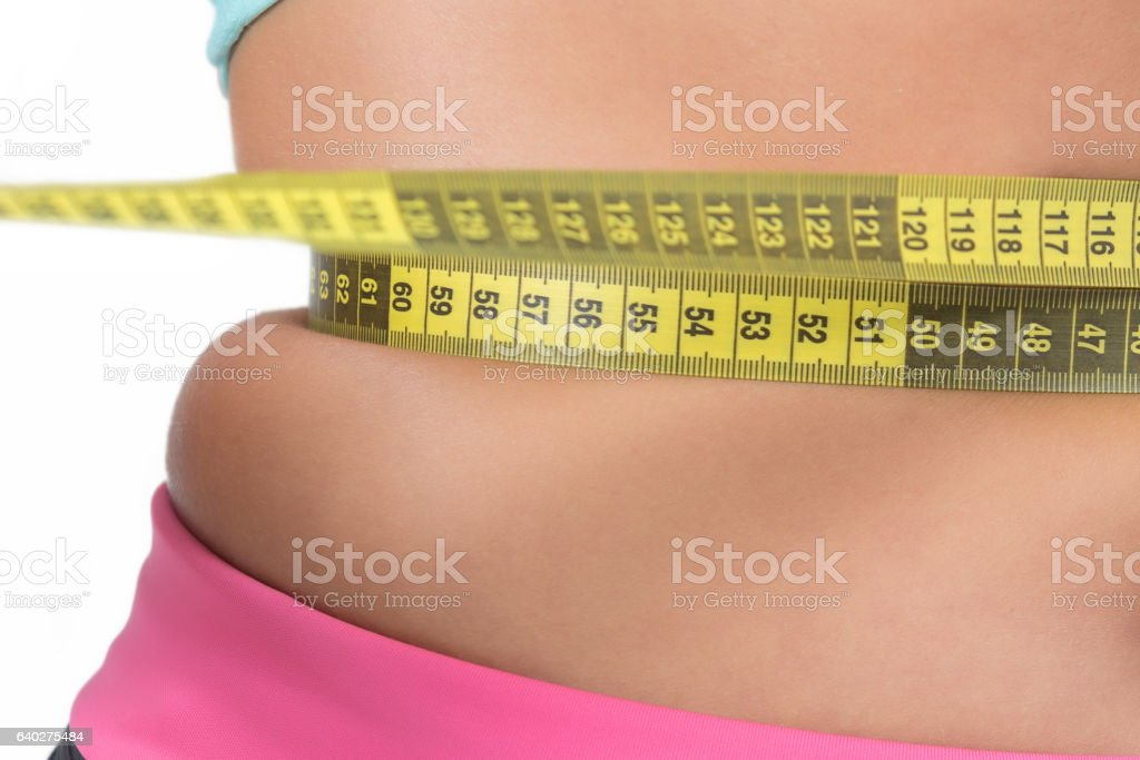 Women's Belly Measuring stock photo